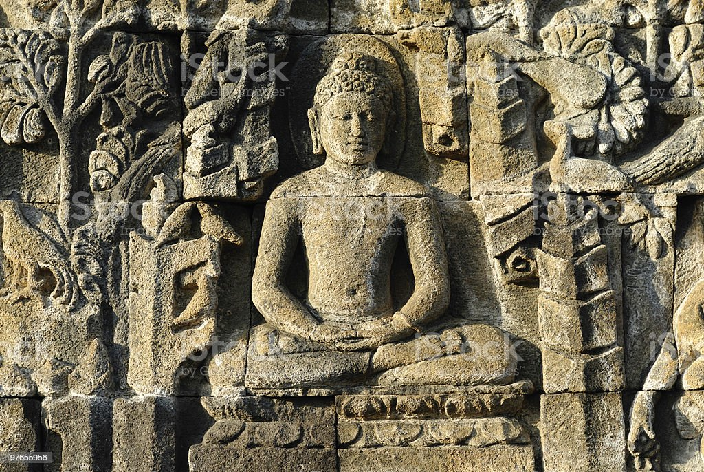 Stone carvings of Borobudur temple in Indonesia royalty-free stock photo