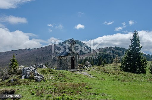 Stone chapel and mountain road in Velebit mountains, Northern Velebit National Park, Croatia