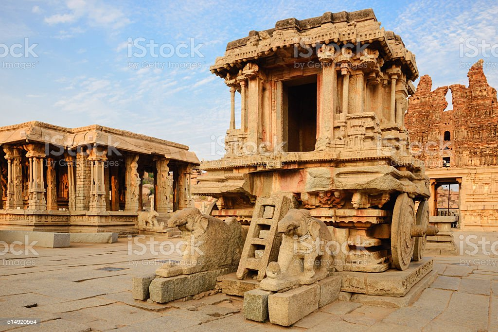 Stone chariot in Hampi Vittala Temple at sunset stock photo