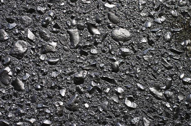 silver effect of graffiti paint on stone chips - whiteway graffiti stock photos and pictures