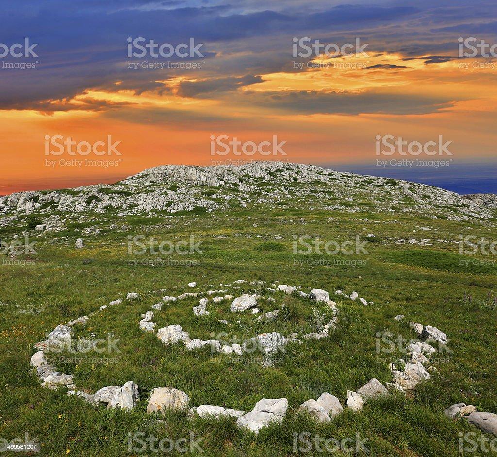 stone circles in mountains stock photo