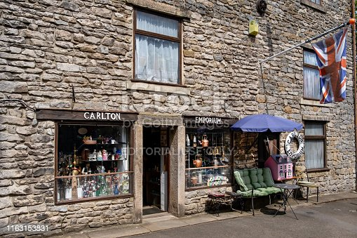 Castleton, Derbyshire, United Kingdom - July 8th, 2019 :  Stone constructed buildings in Castleton.  Castleton is a village in the High Peak district of Derbyshire, England.   It is a popular tourist centre with high numbers of visitors throughout the year.