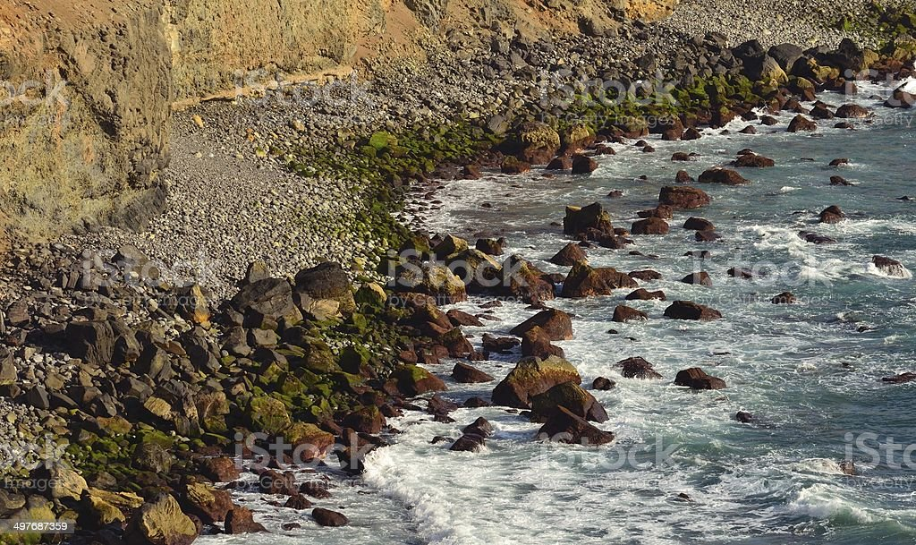 Stone coves with large fallen rocks on the sea royalty-free stock photo