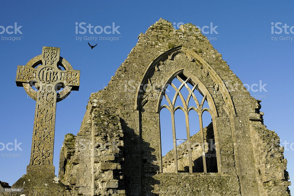 Stone cross and Athenry Friary details royalty-free stock photo