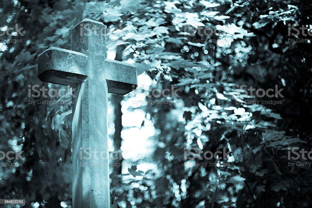 Stone cross in cementary, monochrome stock photo
