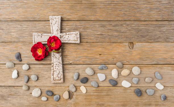 Stone cross with flowers for obituary death background picture id896093452?b=1&k=6&m=896093452&s=612x612&w=0&h=nn vj3prse2mze8gmbyj b9hc3jbw6dkwgwet1zdvcw=