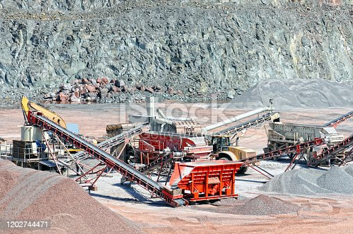 Stone crusher and conveyor belt sorting rock material. quarry. mining industry.
