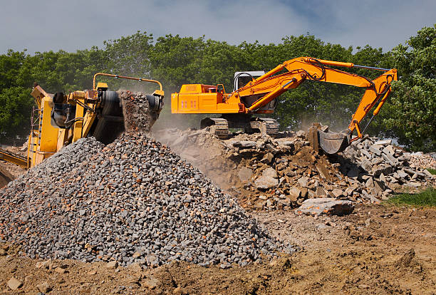 Stone crusher and crane stock photo