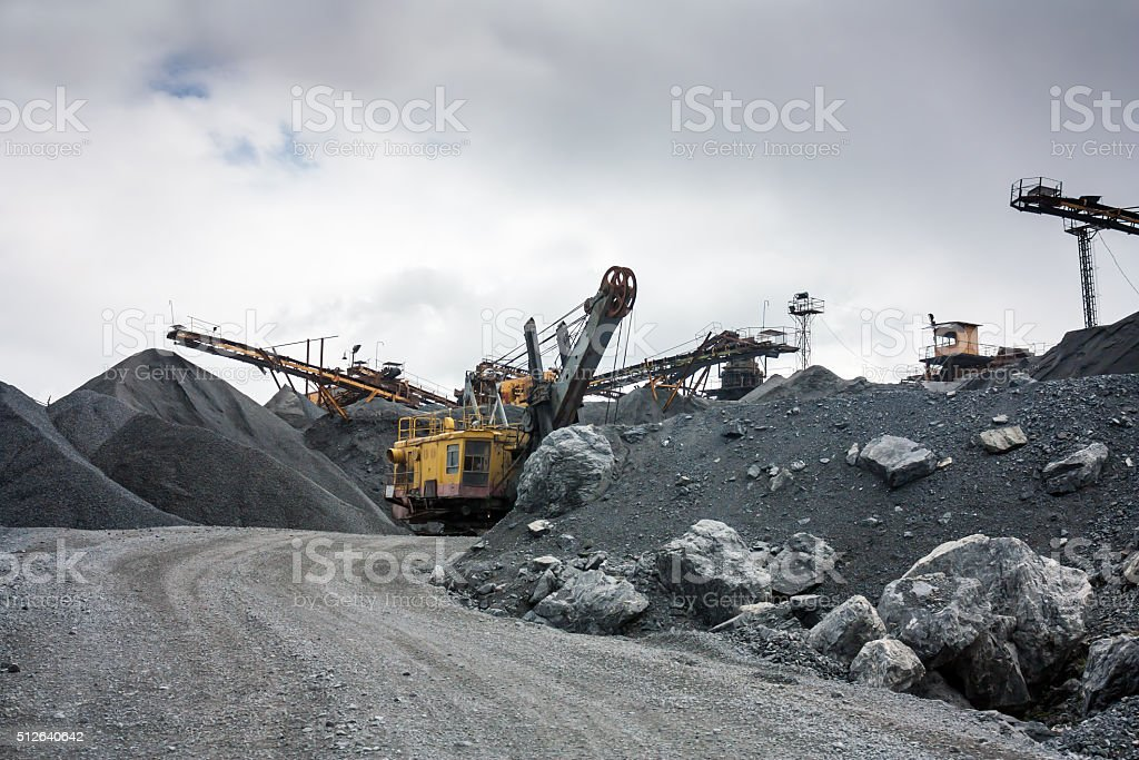 Stone crusher in surface mine quarry stock photo