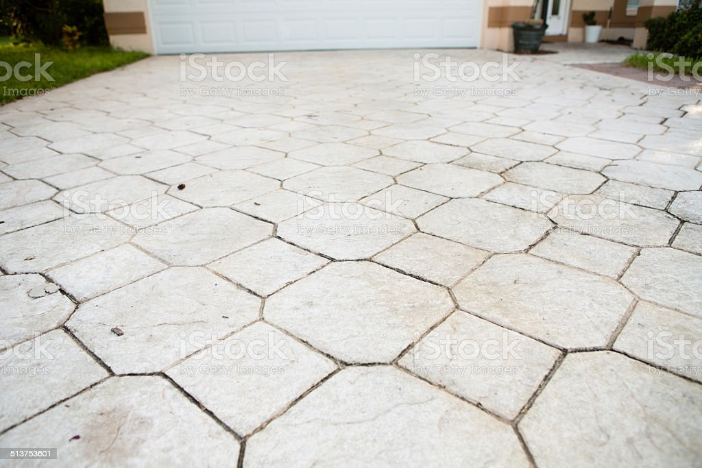 Stone Driveway That Needs to be Power Washed stock photo