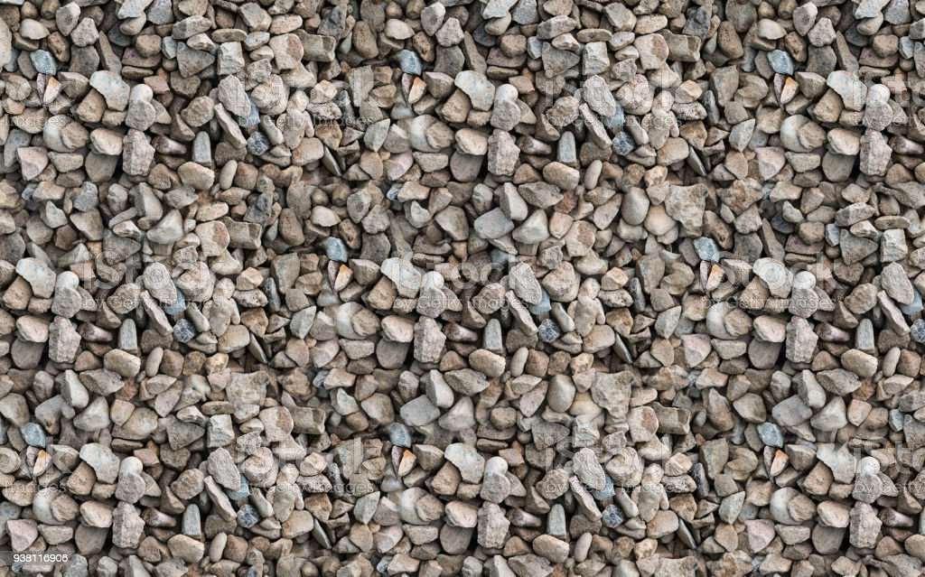 Stone dune mound of gray beige gravel industrial texture background stock photo