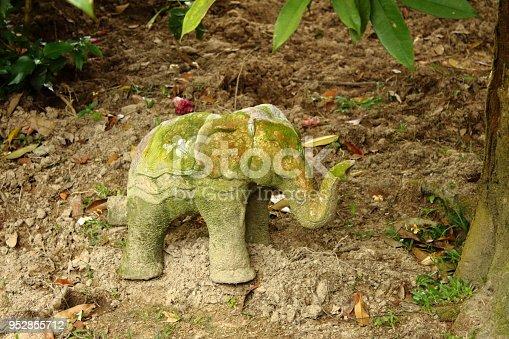 909806032istockphoto Stone elephant decoration in a tropical Buddhist garden 952855712