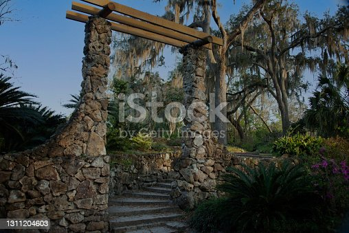 Vintage stone entrance to trailhead in Racine Garden State Park, Stairs,Oak trees with hanging Spanish moss