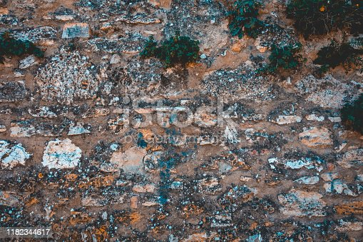 636061068 istock photo stone facade texture for photo backgrounds 1182344617