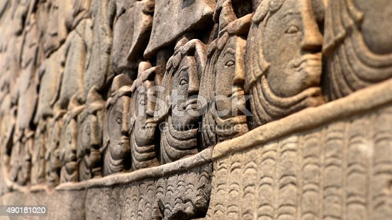 1147569123 istock photo Stone faces of Khmer Army 490181020