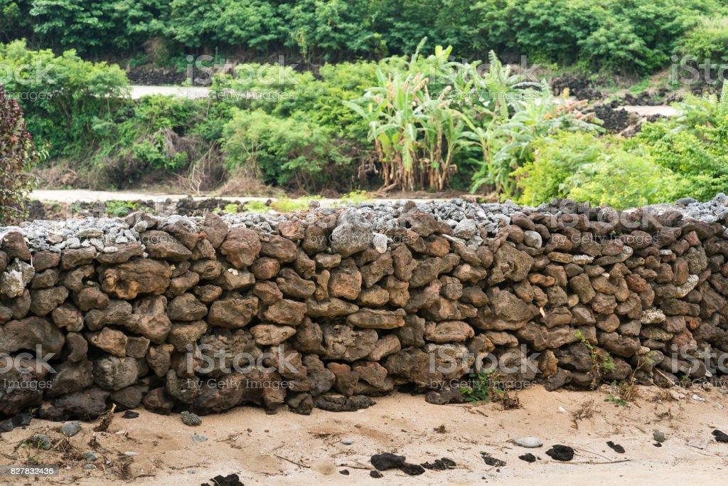Stone fence on Ly Son Island stock photo