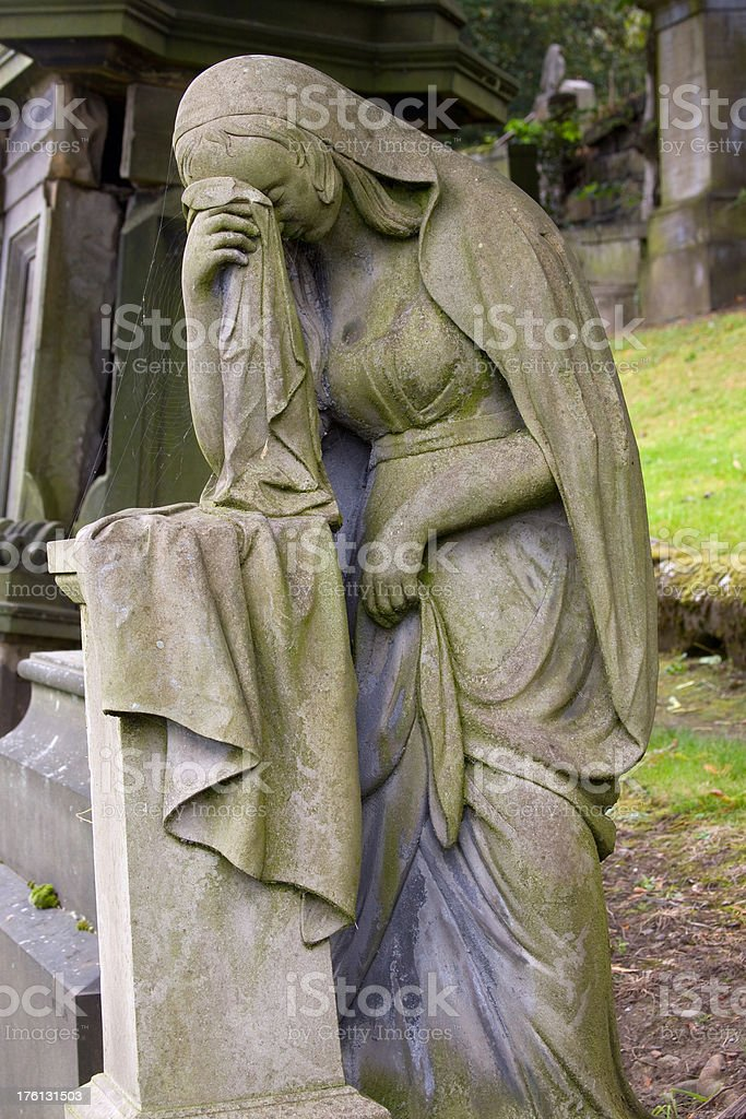 Stone Figure Grieving royalty-free stock photo