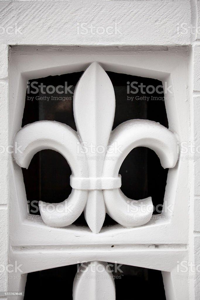 Stone fleur-de-lis stock photo