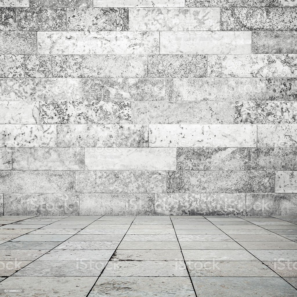 Stone floor tiling and white wall background stock photo