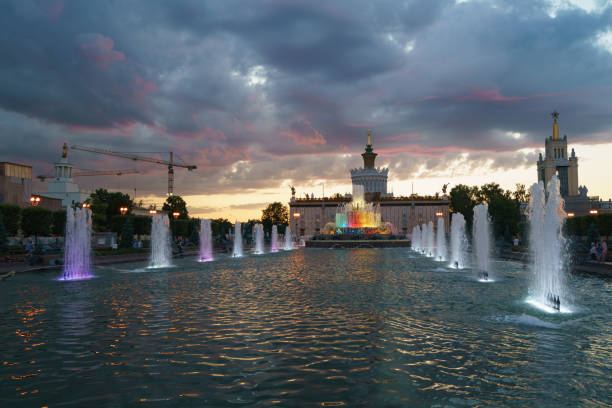 Stone Flower fountain at Moscow VDNkH Moscow, Russia - June 23, 2020: Beautiful refreshing fountain Kamenny Tsvetok / Stone Flower on the Exhibition of Achievements of National Economy (VDNKh) in windy sunset. People resting nearby sopaatervinning stock pictures, royalty-free photos & images