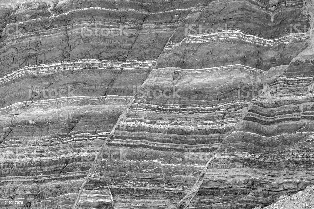 Stone Formation Showing Fault Lines in Black and White stock photo