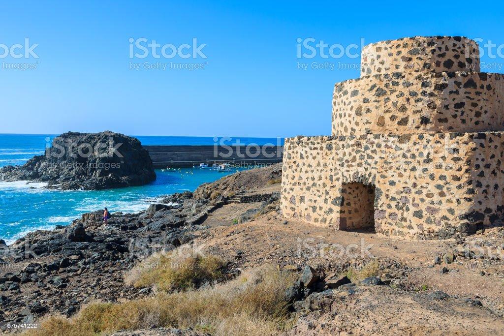 Stone fortress on El Cotillo beach, Fuerteventura, Canary Islands, Spain stock photo