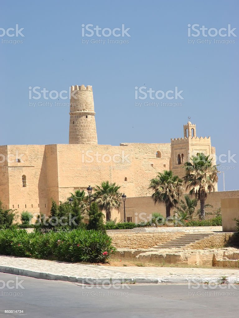 Stone fortress (ribat) with a tower and a mosque in the city of Monastir stock photo