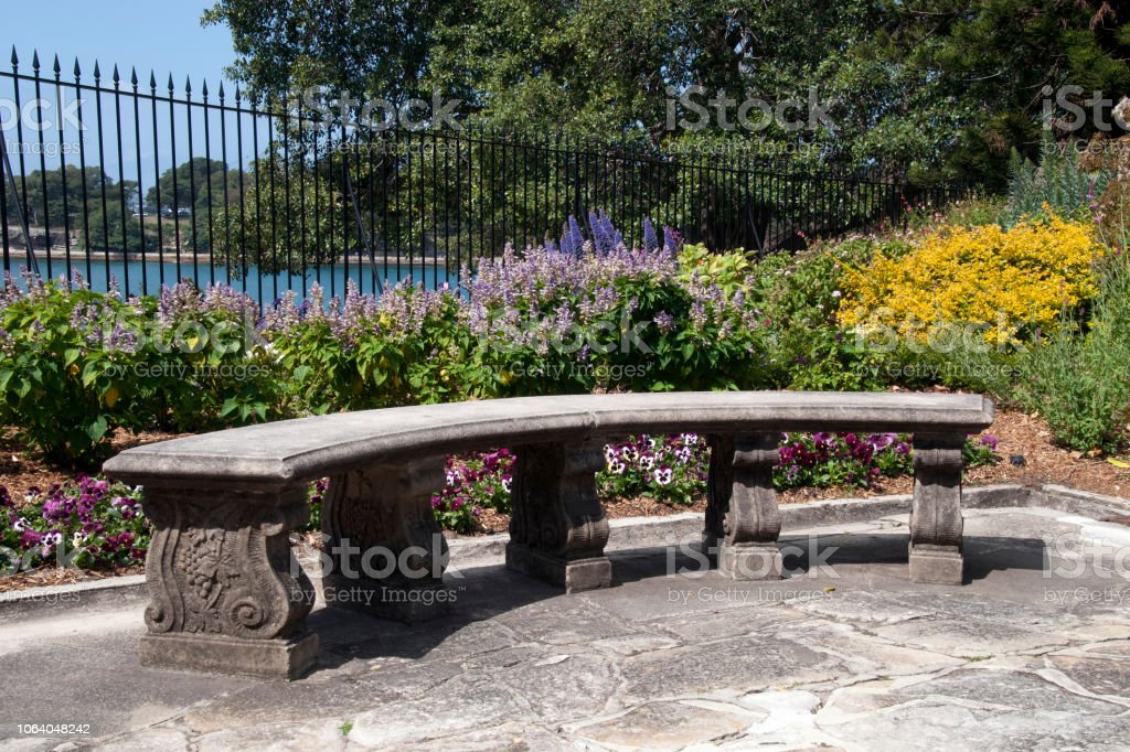 Picture of: Stone Garden Bench With In Garden With Water In Background Stock Photo Download Image Now Istock