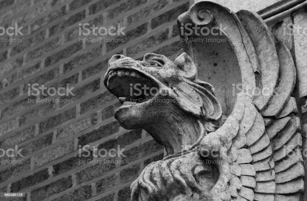Stone gargoyles on a wall royalty-free stock photo