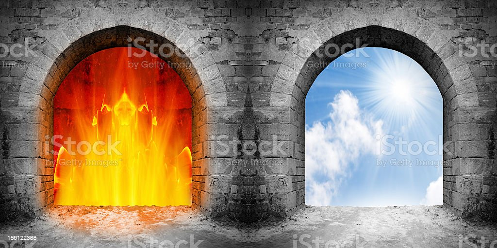 Stone gates leading to a fiery hell or beautiful heaven stock photo
