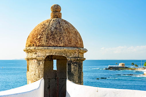 Stone guardhouse on the walls of an old colonial-style fort on the seafront of Salvado in Bahia