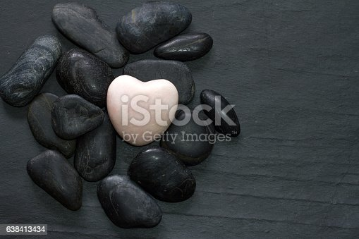 istock Stone heart and other stones 638413434