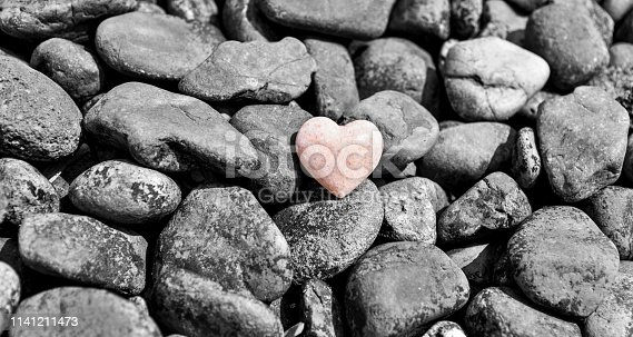 Stone heart in a stone heap.