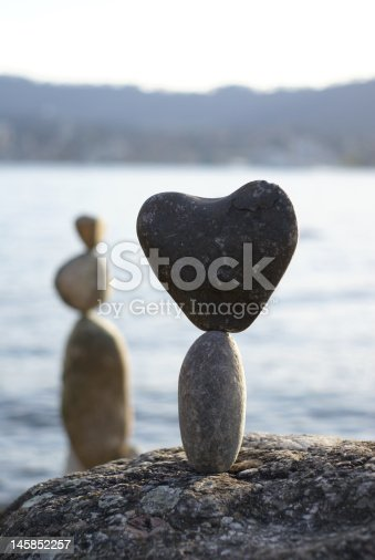 stone heart standing on the another stone
