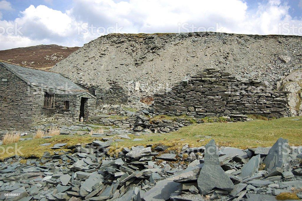 Stone house near Haystacks royalty-free stock photo