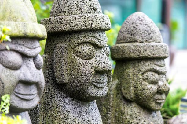 stone idol - hareubang on jeju island in south korea - jeju island stock photos and pictures