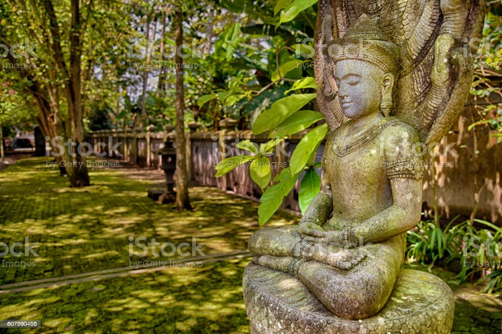 Stone image of Buddha stock photo