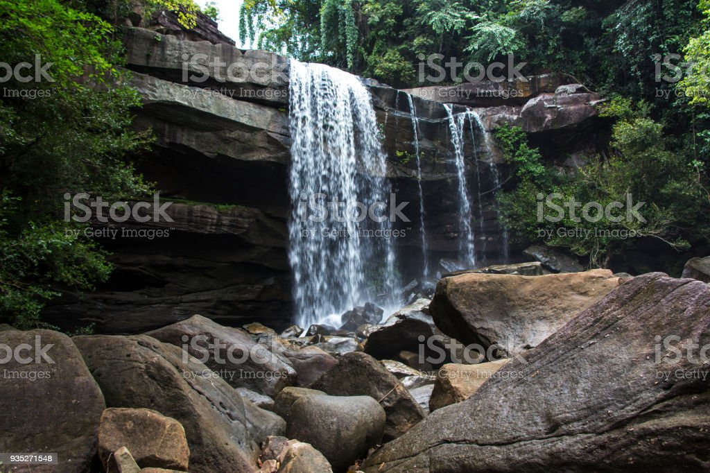 Stone in the forest waterfall stock photo
