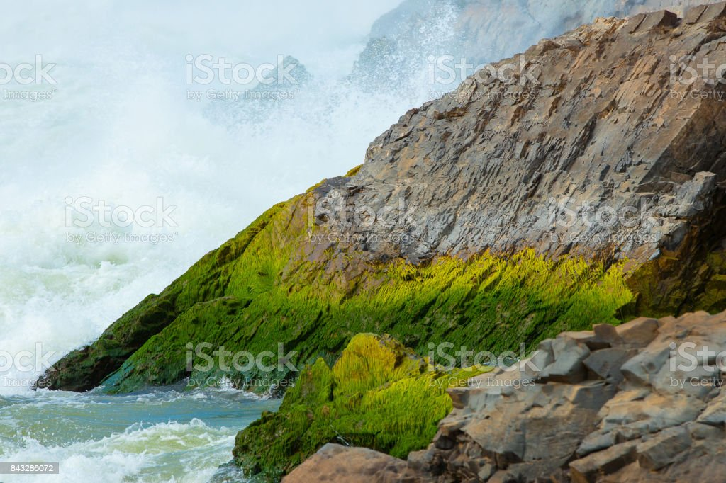 stone in waterfall in Laos. stock photo