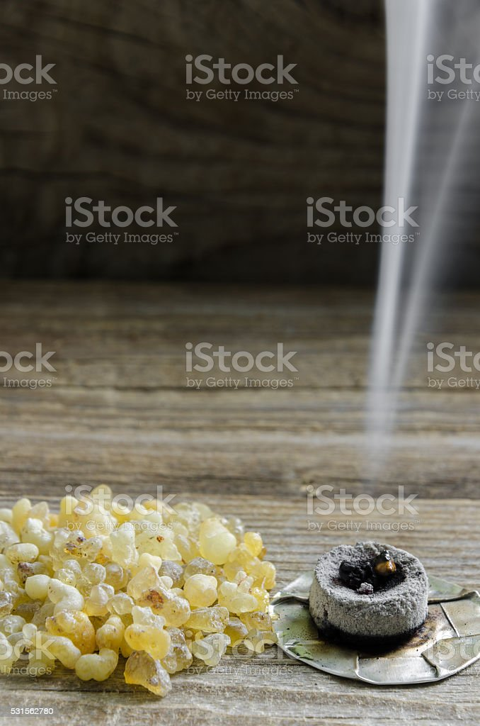 Stone Incense on wooden board stock photo