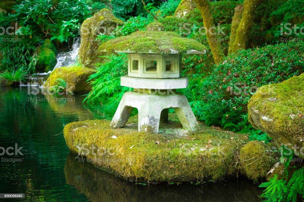 Stone Japanese Yukimi Lantern In Water Zen Garden Royalty Free Stock Photo