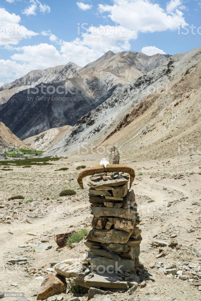 Stone landmark with antlers on top in the Gandala pass stock photo