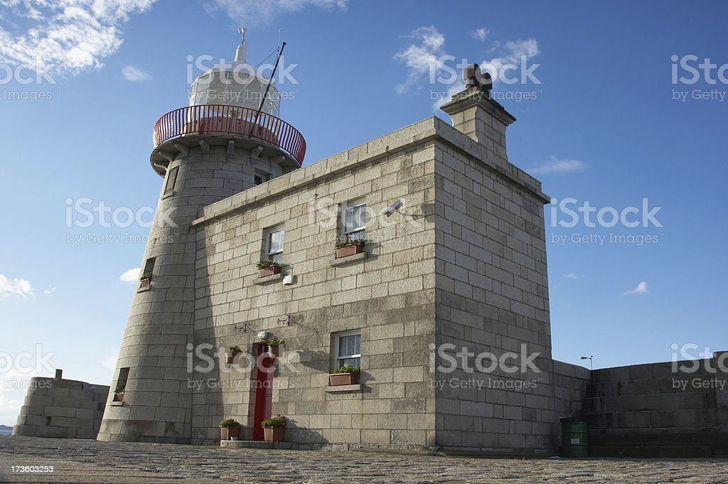 Stone Lighthouse and blue sky royalty-free stock photo