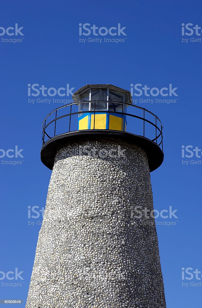 Stone lighthouse royalty-free stock photo