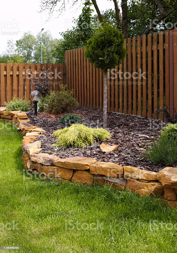 A stone lined decorative garden corner in a back yard royalty-free stock photo