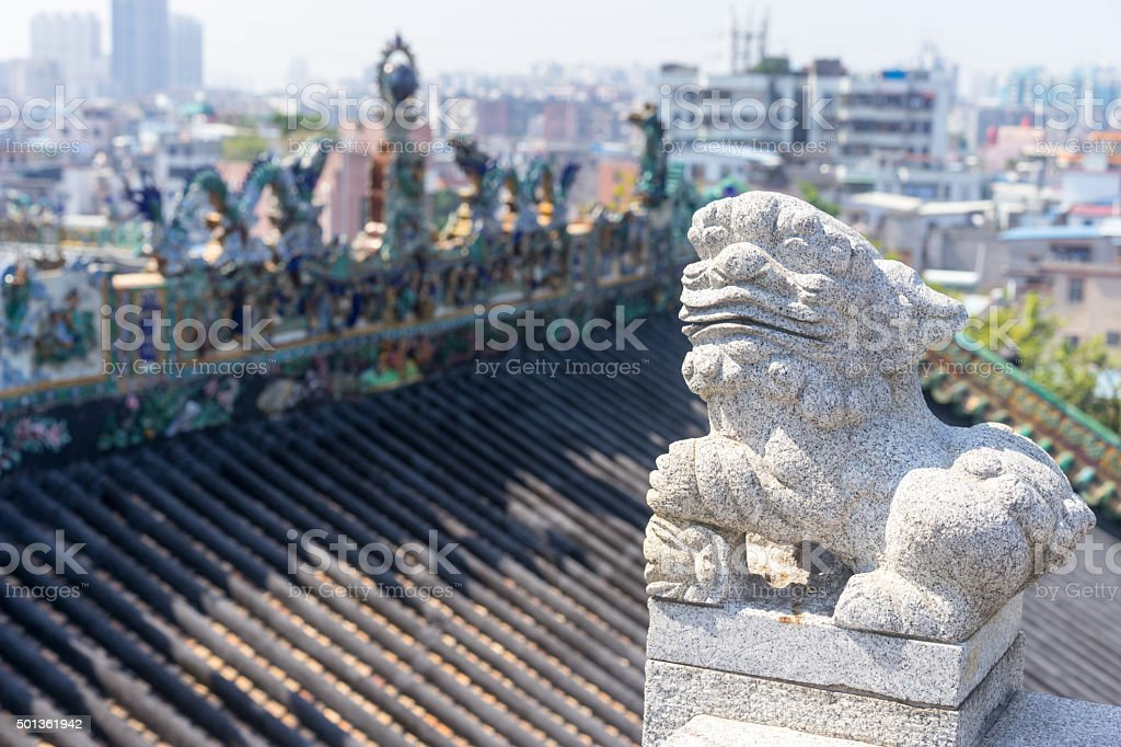 stone lion and sculpture figures on the roof stock photo