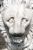 istock Stone lion face close up. Angry lion sculpture. 1315240350