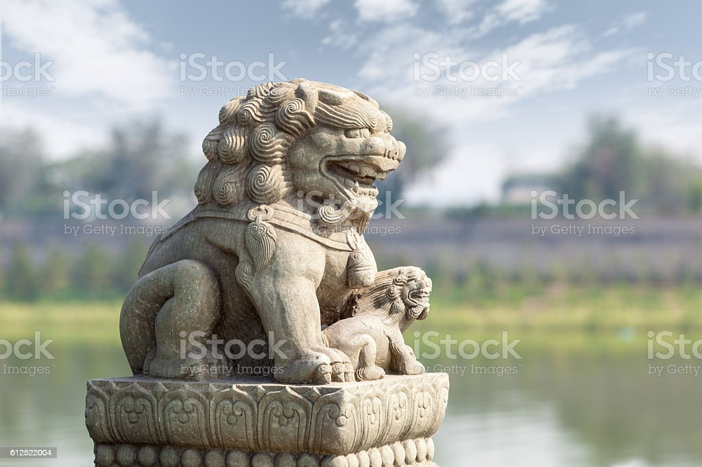stone lion in beijing stock photo