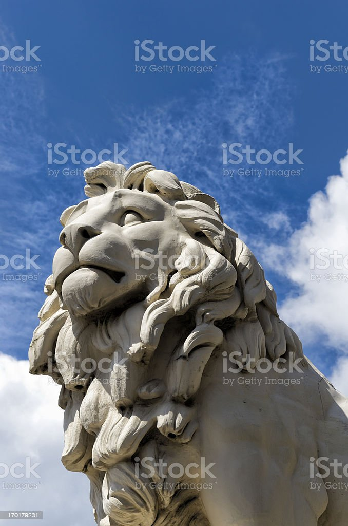 Stone lion looking skywards royalty-free stock photo