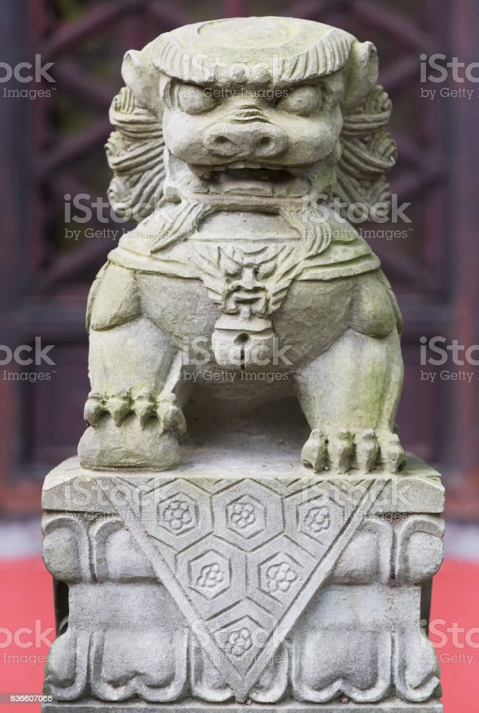 Stone lion statue in a temple stock photo